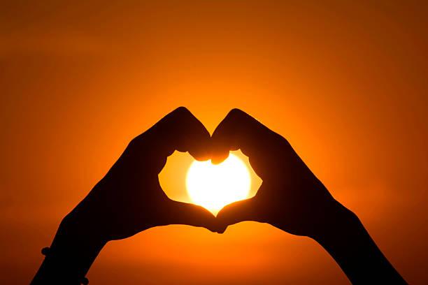 Sun And Heart Symbol